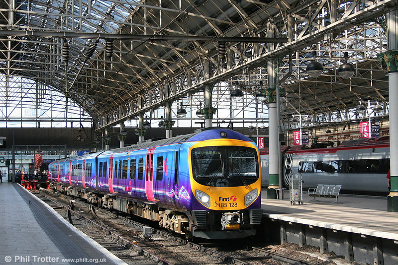 Manchester Piccadilly presents a bright and airy atmosphere, in strong contrast to Victoria on the other side of the City Centre. Here, TPE 185128 waits to leave with the 1257 Manchester Airport to Cleethorpes on 9th September 2006.
