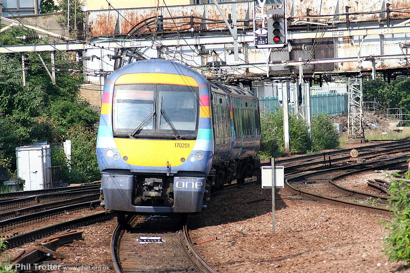 'ONE' has a small fleet of class 170 dmus. This is 1999-built 170201 approaching Stratford on 1st July 2006.