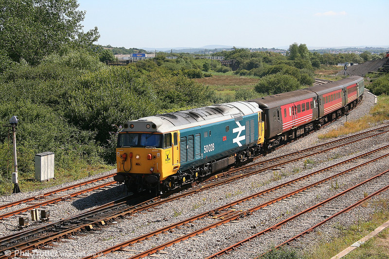 Still carrying the identity of its alter ego, 50031 'Hood' negotiates Llandeilo Junction with the 1055 Cardiff - Fishguard Harbour on 24th July 2006.