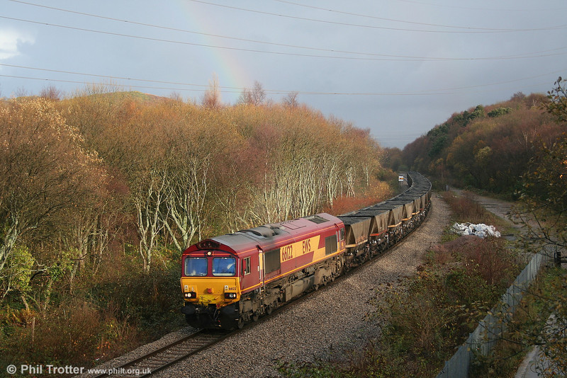 66122 and a rainbow at Jersey Marine with 6C32, 1310 Cwmgwrach to Aberthaw Power Station on 2nd December 2006.