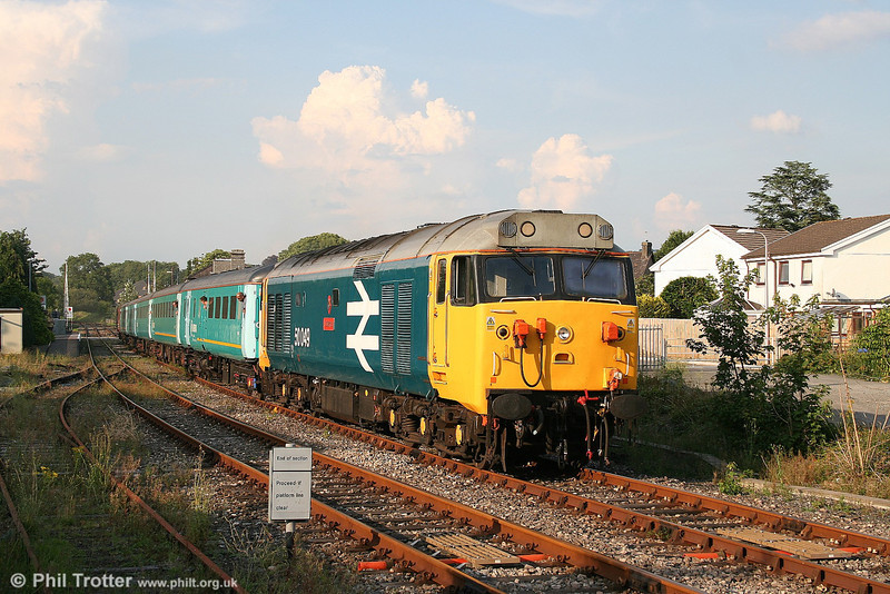 50049 'Defiance' in the evening sunshine at Llandovery with the return 1745 Llandrindod Wells to Cardiff on 25th July 2006. If you're wondering where the loco crew are, they were out taking pictures too!