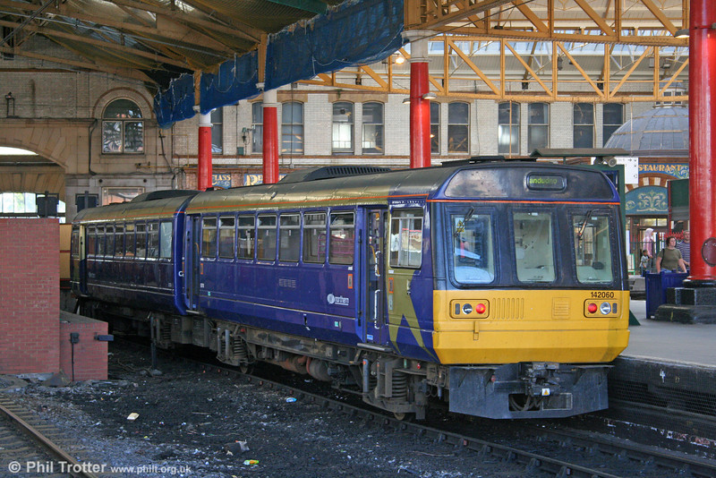 Northern 142060 awaits departure time from Manchester Victoria for Llandudno on 9th September 2006.