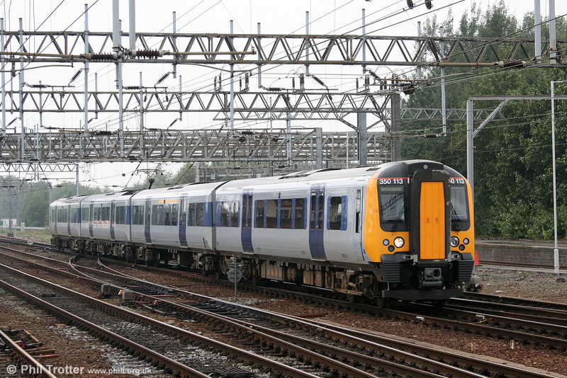 In its original livery, 350113 approaches Crewe with a Liverpool to Birmingham working on 5th August 2006.