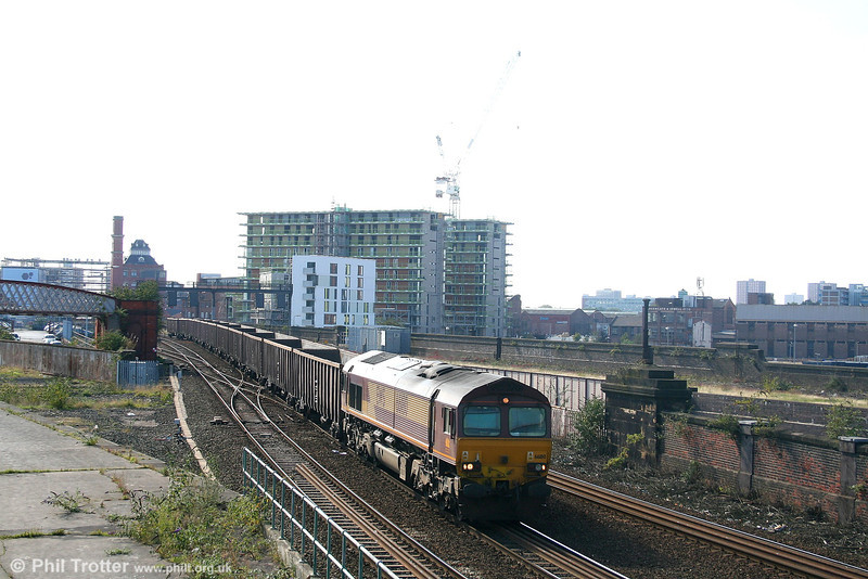 One of the few freights booked through Manchester Victoria on Saturdays is 6M07, the 1045 Roxby - Pendleton empties, seen here headed by 66180 on 9th September 2006.