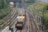 The extension of car parking facilities at Crewe now means that it is at last possible (legally!) to access the avoiding line from the station platforms (at least until the bushes grow). Here two unidentified DRS class 20s head away from the tunnel with a nuclear flask in tow on 5th August 2006.