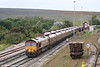 66188 at Aberthaw ready to run around a train of empty HTAs on 2nd September 2006. Note the lamps bending in the high wind!