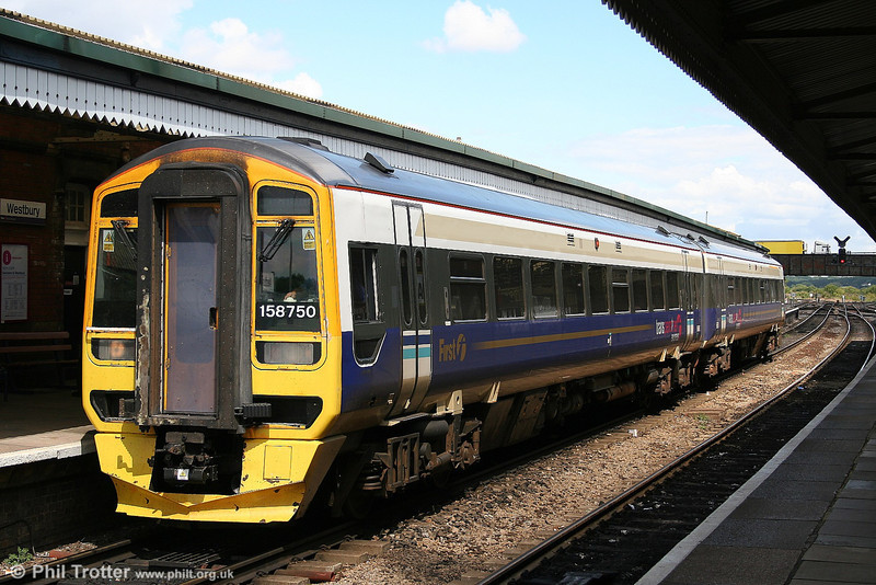 Displaced by new class 185 units, several Trans Pennine class 158s have found their way to the South West. 158750 pauses at Westbury with the 1240 Bristol Temple Meads to Brighton on 2nd August 2006. Note the TPE vinyls applied over the unit's original Regional Railways livery!
