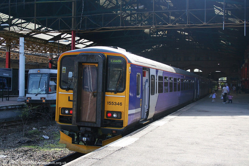 Displaying a version of Northern's new livery, 155346 waits at Manchester Victoria ready to form the 1524 to Leeds via Bradford on 9th September 2006.