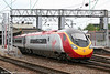 390047 'Virgin Atlantic' departs from Crewe for the north on 5th August 2006.