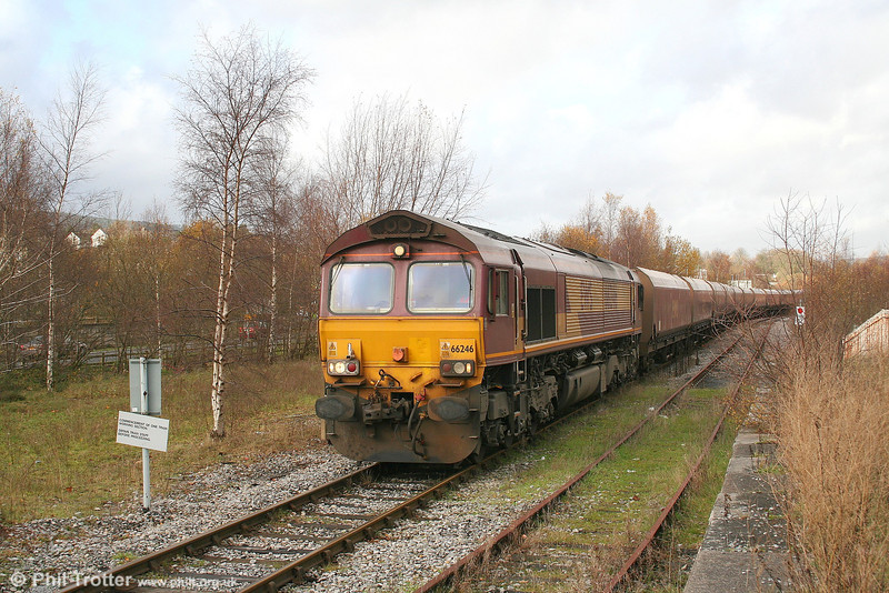 66246 waits at Aberdare for an Arriva passenger service for Cardiff to clear the section with 6C45, 1054 Tower Colliery to Aberthaw Power Station. 27th November 2006.