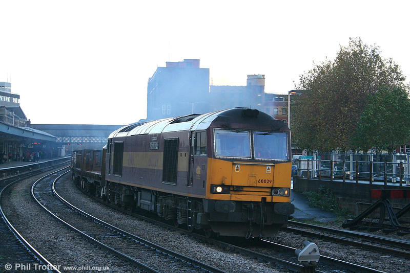 The exhaust of 60029 'Clitheroe Castle' adds to the gloom at Newport with 6H26 the 1520 Llanwern to Margam empty steel on 25th November 2006.