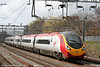 An unidentified Virgin West Coast 'Pendolino' class 390 speeds south through Tamworth on 30th March 2006.