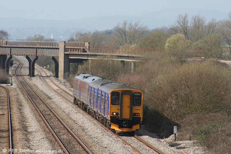 Bishton Flyover provides a backdrop to FGW's reliveried 150249 and a former TPE class 158 unit forming the 1200 Cardiff - Southampton at Llandevenny on 17th March 2007.