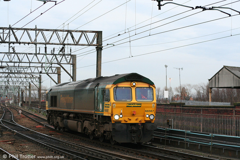 Freightliner's work stained 66567 runs light from Crewe through Manchester Piccadilly, probably to pick up 4O08, 1919 Trafford Park - Southampton on 8th March 2007.