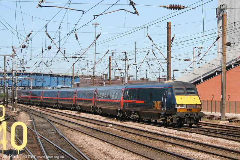 The 1100 Edinburgh - King's Cross, headed by a GNER DVT, approaches Doncaster on 30th April 2007.