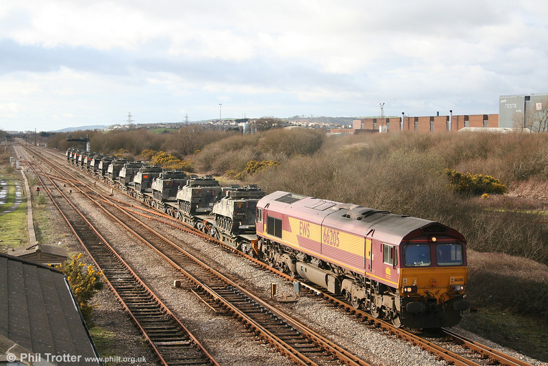 66205 at Llandeilo Junction with a train of thirteen British Army Warrior AFVs on Warwell wagons, forming 7X39, 1359 Haverfordwest to Didcot Yard on 25th February 2007.