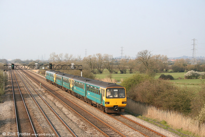 Led by 143605, a pair of ATW's 143s and a 142 form a Cardiff - Newport football shuttle at Coedkernew on 1st April 2007.