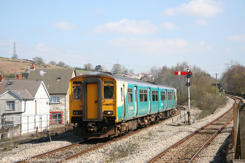 150260 pulls away from Abercynon North with the 1122 Aberdare - Barry Island on 9th April 2007. The Merthyr line from Abercynon South runs to the right of the picture.