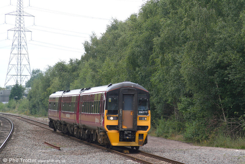The latest livery variation to adorn class 158s, Trans Pennine maroon with Central Trains markings, is carried by 158777 seen passing Water Orton with the 1145 Cardiff to Nottingham on 7th August 2007. With the Central Trains franchise ceasing in November 2007, it is clearly not worth repainting these units into Central Green.
