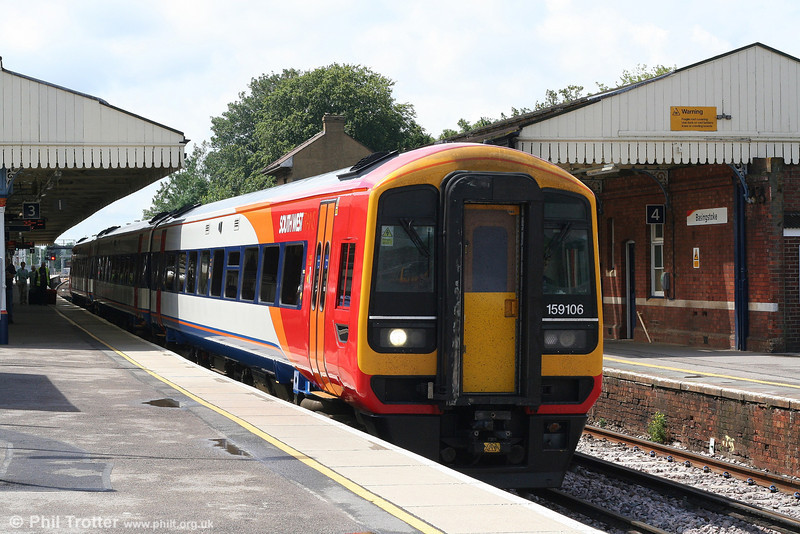 SWT 159106 departs Basingstoke forming the 1320 Salisbury - London Waterloo on 16th June 2007. 159106 is formed from the refurbished former Trans Pennine Express unit 158809.