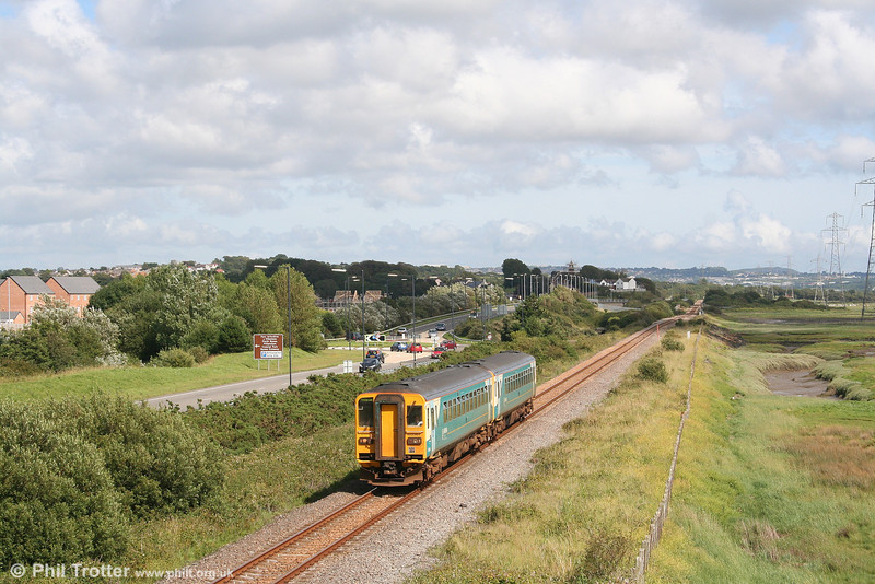 A sunny day at last! 153367 and 153353 create an impression of a class 155 - from which they were of course converted - as they pass Loughor forming the 1605 Swansea to Pembroke Dock on 14th July 2007.