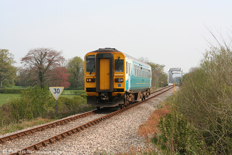 ATW's 153323 at Glanrhyd, forming the 0905 Shrewsbury - Swansea on 21st April 2007. The unit has just crossed the River Towy on a bridge constructed in 1988 to replace the original which collapsed on 19th October 2007 as a result of flooding.