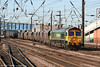 66562 runs south through Doncaster with 6C11, 1423 Redcar - West Burton coal on 30th April 2007.