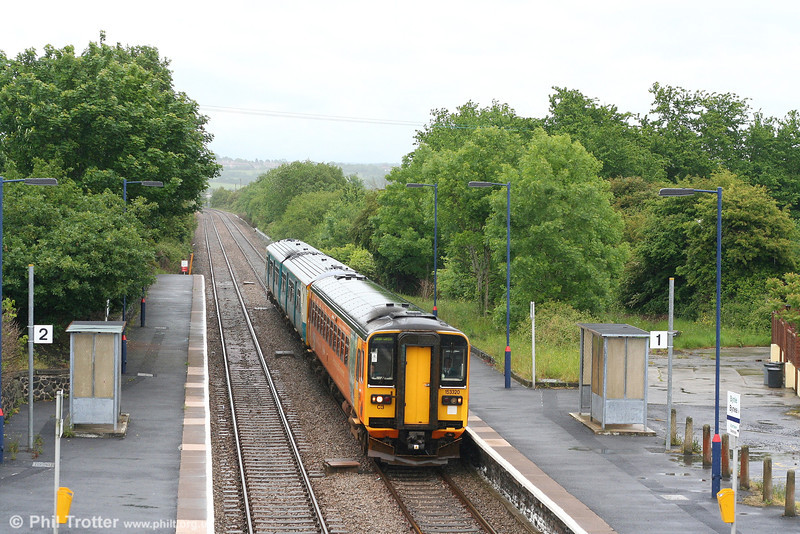 153320 and a class 150 call at Bynea forming the 1207 Shrewsbury to Swansea on 27th May 2007.
