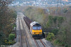 In weak autumn sunshine, 60035 ambles through Felin Fran, Swansea District Line with 6B16, 1535 Trostre to Margam empties on 3rd November 2007.
