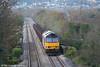 In weak autumn sunshine, 60035 ambles through Felin Fran, Swansea District Line with 6B16, 1535 Trostre to Margam empties on 3rd November 2007.