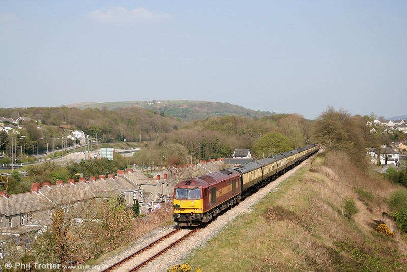 Shot of the day! 60038 'Avesta Polarit' heads through Aberdulais with 1Z74, the wonderfully titled 1453 Cwmgwrach - Birmingham International on 14th April 2007. The remains of Aberdulais Halt are towards the rear of the train.