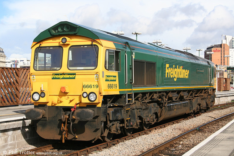 Freightliner 66619 'Derek W. Johnson MBE' sits in platform 0 at Cardiff Central, awaiting clearance to proceed across to Canton Depot for servicing. 19th March 2007