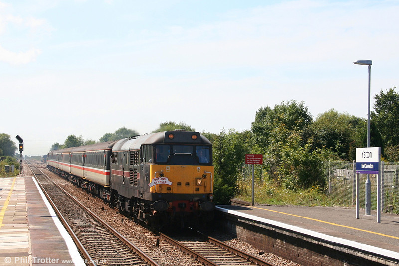 31452 'Minotaur' heads through Yatton with 1Z35, 1110 Minehead to Bristol Temple Meads 'Butlins Express' on 11th August 2007. The nameboard which states 'Yatton for Clevedon' is perhaps a little over optimistic, bearing in mind that trains to Clevedon ceased in 1966!