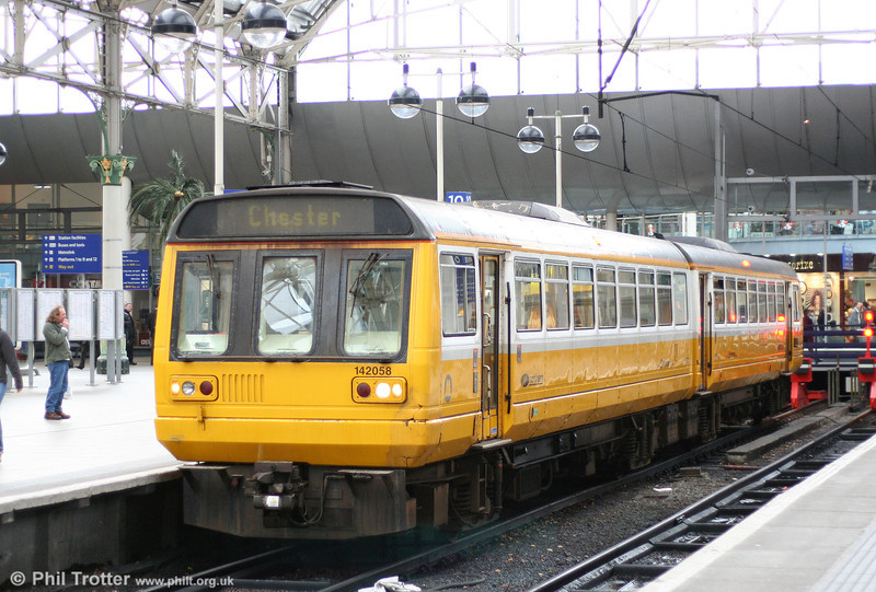Northern's Merseyrail liveried 142058 waits to leave Manchester Piccadilly for Chester on 8th March 2007.