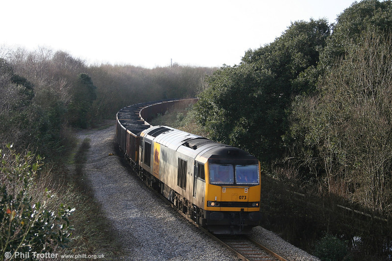 The next sequence shows 6F76, 1013 Parc Slip - Onllwyn and return which ran on 20th January 2007. Here 60073 'Cairn Gorm' heads through Jersey Marine with the train of MEAs.
