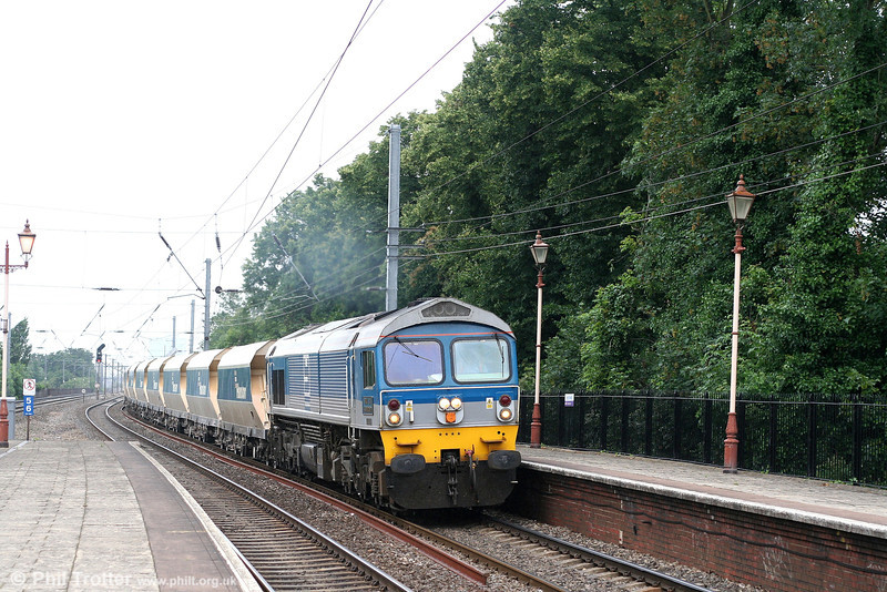 Yeoman 59004 'Paul A Hammond' passes through Hanwell with 6A21, 1324 Whatley - Acton Yard on 5th July 2007.