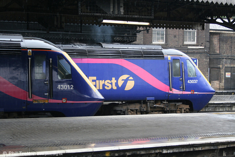 Illustrating a livery which is likely to be extinct before the end of 2007, FGW's 43012 and 43037 'Penydarren' wait to leave Paddington with lunchtime services for the west on 21st May 2007.