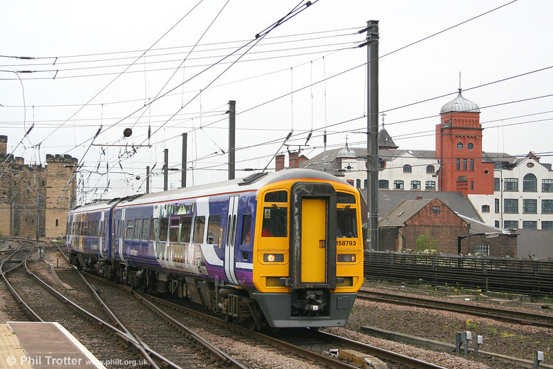Northern is gradually repainting its varied fleet into a standard livery. 158793 arrives at Newcastle with a mid-morning Middlesborough - Hexham service on 4th May 2007. 158793 previously worked for First Great Western, but in Central Trains green livery!