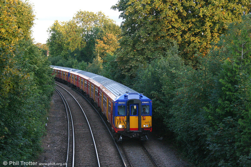 Evening draws in as class 455/8 (distinguished by the air horns on the roof) no. 455 851 approaches Teddington forming the 1957 London Waterloo to London Waterloo via the Kingston Loop (clockwise) on 24th July 2007.