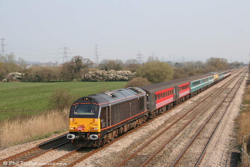 Royal claret liveried 67005 'Queens Messenger', plus coaches in a variety of liveries, at Coedkernew with 1Z47, 0840 Doncaster to Cardiff Footex on 1st April 2007.