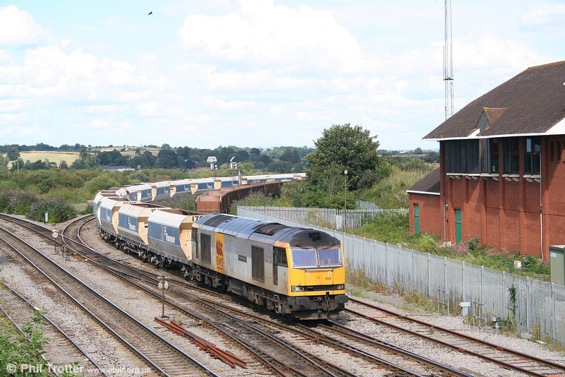 60055 'Thomas Barnardo' approaches Westbury with 6V18, 1243 Hither Green to Whatley empty Hanson hoppers on 6th August 2007.