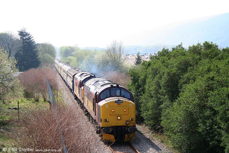 37422 and 37410 head through Resolven with 1Z74, the 'Principality Freighter' for Cwmgwrach on 14th April 2007.