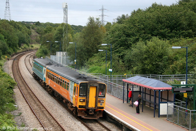 153303 calls at Llansamlet with a Cardiff to Swansea stopping service on 3rd August 2007.
