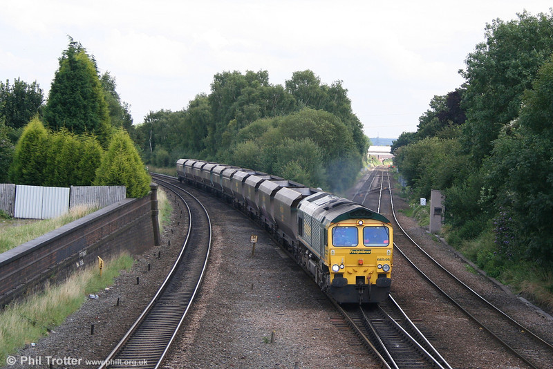 66546 heads empty FHH coal hoppers through Water Orton East Junction on 7th August 2007.