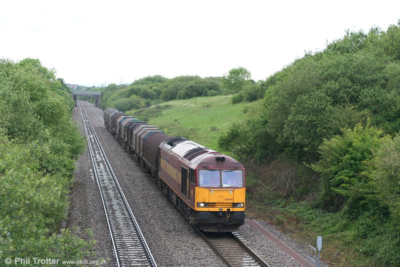 60045 'The Permanent Way Institution' climbs Stormy bank with loaded steel from Margam on 27th May 2007.