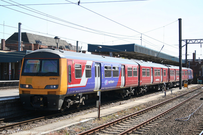 321902 in the new style livery waits to depart from Doncaster for Leeds at 1427 on 30th April 2007.
