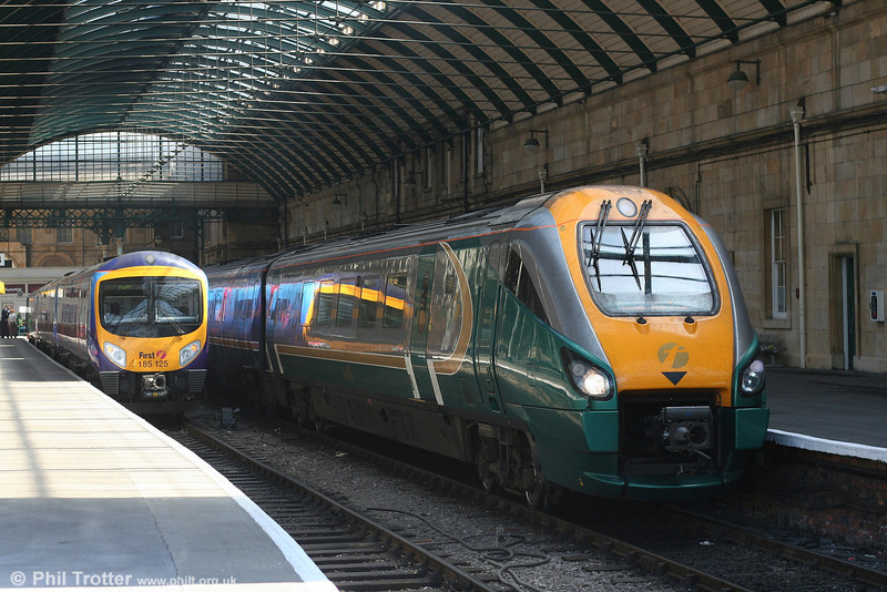 The modern scene at Hull; 222102 prepares to leave with the 1245 to London King's Cross, while TPE 185125 has just arrived from Manchester. 1st May, 2007.
