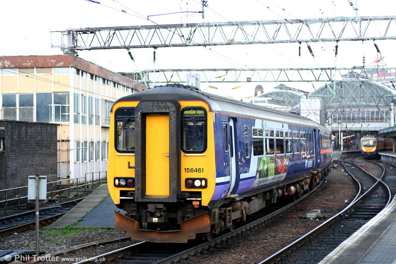 Northern inherited a fleet of units in a hotch-potch of liveries from former franchise holders. 156461 has been repainted in Northern corporate colours and leaves Manchester Piccadilly with the 0610 Liverpool - Manchester Airport on 9th March 2007.