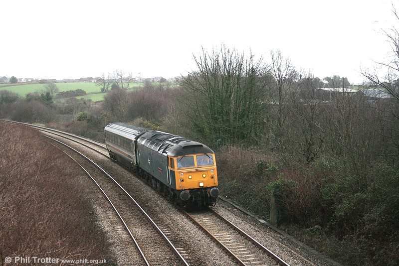 Heading home: Former WR named class 47 47840 'North Star', previously D1661, runs through Llansamlet with 5Z86, 1045 Old Oak Common - Landore TMD on 11th February 2007. The loco, built in 1965, was allocated to Landore when new. Now back in BR blue livery, 47840 will enter preservation in May 2007 when it is handed over to the DEPG at the West Somerset Railway.