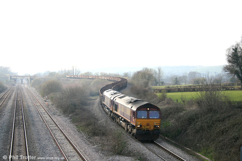 66006 and 66027 descend from Bishton Flyover with ballast empties on 24th March 2007.